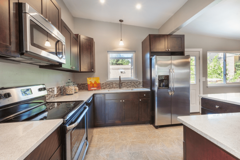 Clean White/Cream Countertops with Brown Cabinets