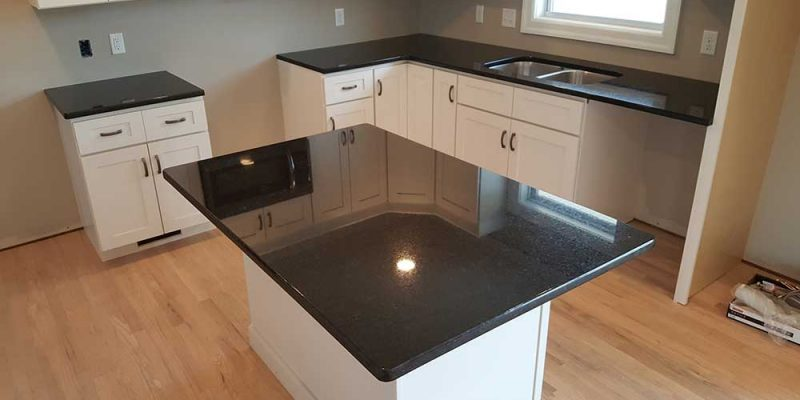 Black Pearl with White Cabinets and wood flooring